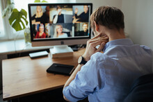 Man Fatigue During Home Video Conference Meeting Call. Post-work Exhaustion From Constant Face-to-face Digital Interactions. Working Remotely Stay Connected During Pandemic To Combat Loneliness
