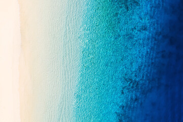 Waves as a background from top view. Azure water background from drone. Summer seascape from air. Gili Meno island, Indonesia. Travel and vacation image