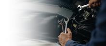 Car Service, Repair, Maintenance Concept. Auto Mechanic Working In Garage.