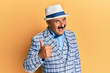 Mature Middle East Man With Mustache Wearing Vintage And Elegant Fashion Style Doing Happy Thumbs Up Gesture With Hand. Approving Expression Looking At The Camera Showing Success.