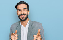 Young Hispanic Man Wearing Business Clothes Pointing Fingers To Camera With Happy And Funny Face. Good Energy And Vibes.