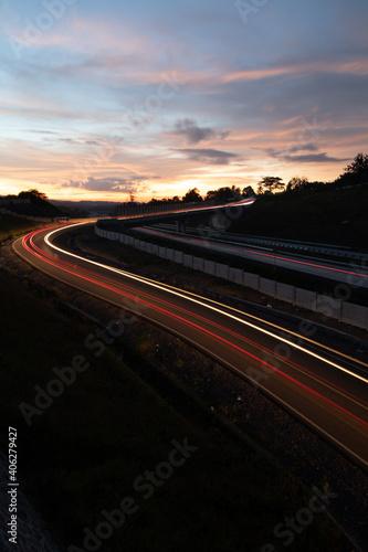 Fototapety, obrazy: Light Trails On Road Against Sky At Sunset