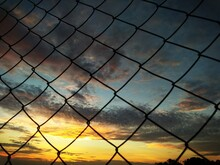 Sunset Over Fence