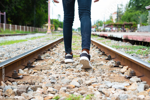 Fotografie, Obraz Low Section Of Person Walking On Railroad Track