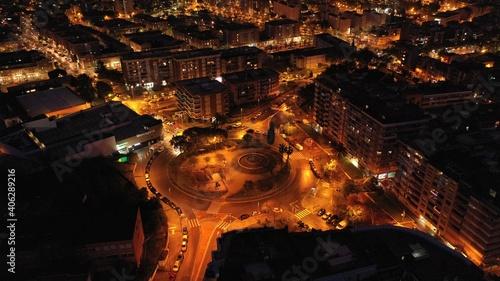 Fototapeta High Angle View Of Illuminated Street Amidst Buildings In City obraz na płótnie