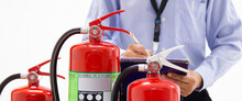 Fire Engineering Using Checklist To Inspection Checking Pressure Gauge Fire Extinguishers Tank In The Building Concepts Of Protection And Prevent For Emergency And Safety Rescue And Fire Training.