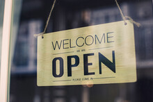 """Wooden Door Sign With The Text """"open"""" And The Idea Of opening A Small Business Activity Again After The Incident Of Covid-19 Ended The Lock And Went Through A Crisis."""