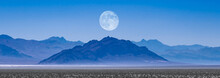 Scenic View Of Mountains Against Clear Blue Sky With A Rising Moon