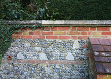 Ancient Weathered Wall Showing A Combination Of Bricks, Files And Flint