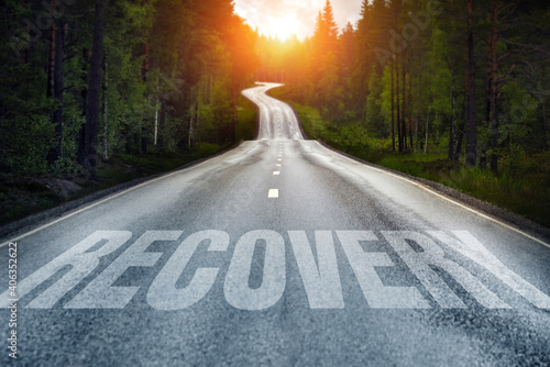 Foto Country road and Recovery written on the road