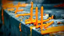 Orange Burnt Candles On Stone Wall