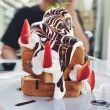 Close-up Of Hazelnut Honey Toast Ice Cream On Plate In Dazzling Cafe