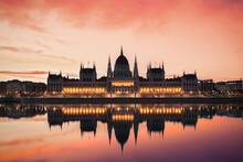 Danube River In Front Of Hungarian Parliament Building Against Dramatic Sky