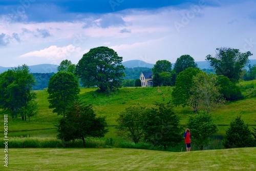 Fototapeta Man Standing On Golf Course Against Sky