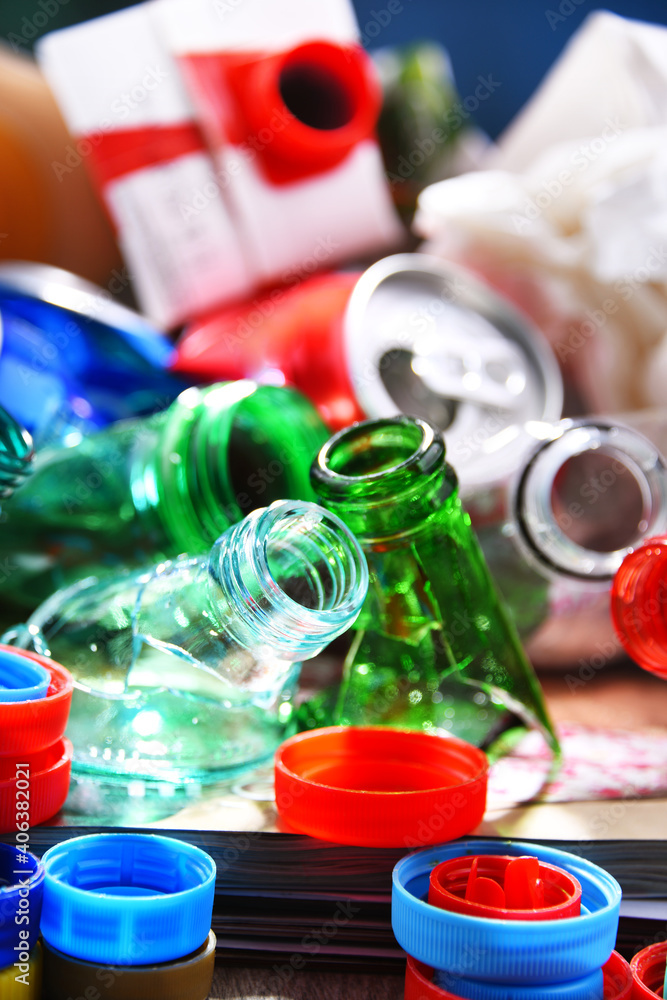 Fototapeta Recyclable garbage consisting of glass, plastic, metal and paper