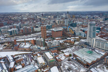Aerial Photo Of The Town Centre Of Leeds In West Yorkshire, Near The Bridgewater Place Apartment Building Along Side The Leeds Train Station In The Snow And Winter Time