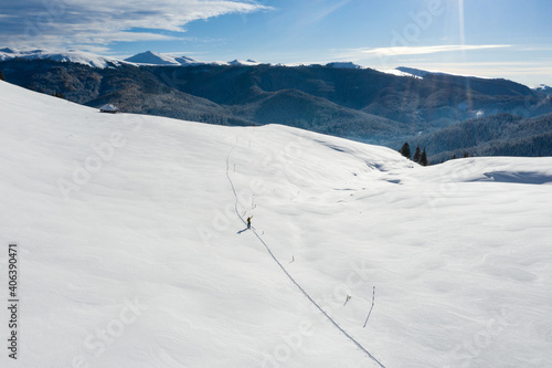 Aerial drone photograph with skier touring in Bucegi mountains, Carpathian range, Romania