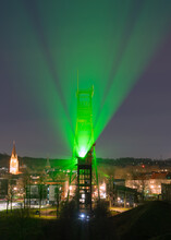 Bright Green Light Projecting From The Pit Headframe Of Erin Coal Mine In Ruhr Metropolis, Germany