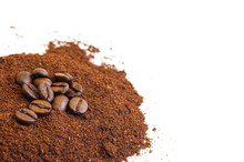Roasted Coffee Beans At The Top Of A Pile Of Ground Coffee On An Isolated White Background. With White Area For Copy Space Text.
