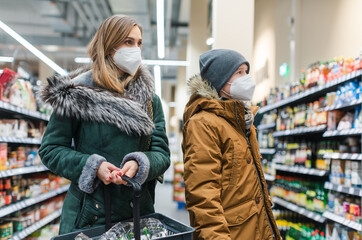 Fototapeta Boks Family shopping in supermarket during covind19 pandemic