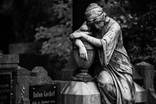 Sad Statue In Cemetary In Black And White
