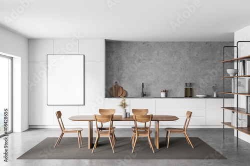 Obraz White and concrete kitchen with table and poster - fototapety do salonu