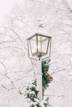 Lantern In The Snow With Christmas Decorations