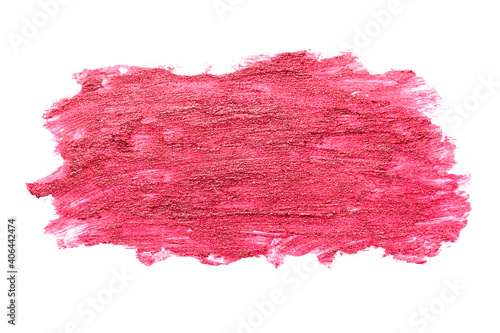 Close up of pink lipstick smudge or smear isolated on white background