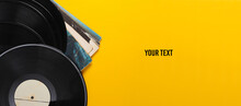 Vinyl Record Albums Isolated On Yellow Background. Copy Space. Top View