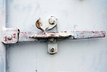 Old Locking Handle Of White Metal Intermodal Container.
