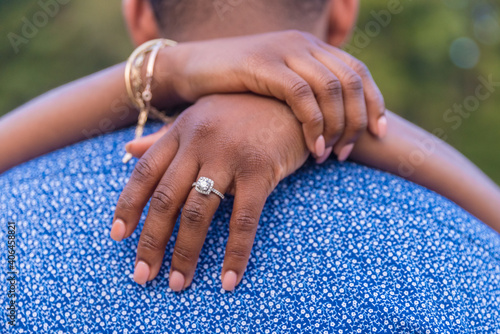 Fototapeta Shallow focus closeup of the couple hugging on their engagement in Kennesaw Mountain in Marietta obraz