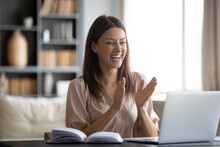 Overjoyed Young Woman Looking At Laptop Screen, Surprised By Good News, Looking At Laptop Screen, Sitting At Work Desk At Home, Excited Female Celebrating Success, Clapping Hands, Online Win