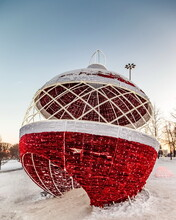 Decorations Of The City Park In The Form Of Christmas Balls With Lighting In The Evening