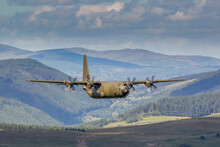 RAF (Royal Air Force) Green Camouflage Lockheed C-130 Hercules Transport Flying Low Level In The United Kingdom.