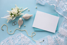 Wedding Card Design In Pastel Colors. Flowers, Pearls, Pearls, Figurines Of White Birds And Space For Text. Flat Lay. Congratulation. Invitation