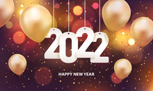 Happy New Year 2022. Hanging White Paper Number With Gold Balloons And Confetti On A Colorful Blurry Background.