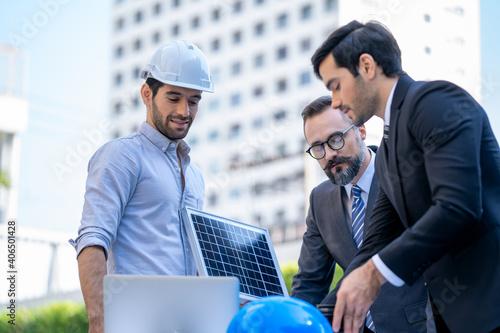 Fotografia Two businessmen discuss about renewable energy solar panels on s