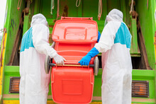 Portrait Of Garbage Collector In Hazmat PPE Protective Clothing
