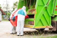 Two Garbage Men In Hazmat PPE Protective Clothing Wear Medical R