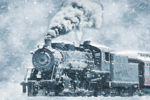A Restored Steam Engine Steamed Up In A Snow Storm With Icicles On It