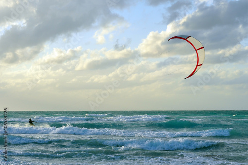 Canvas Man kitesurfing in Atlantic Ocean with dramatic weather