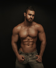 Fitness Male Model Standing On Dark Background