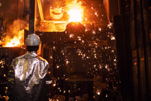 Melting Iron In Foundry And Worker Controlling The Process Iron Casting And Production. Metallurgy And Heavy Industry.