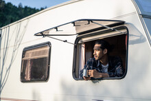 Asian Young Handsome Man Open The Window Of Campervan, Drinking Coffee