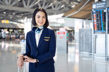 Portrait Of Caucasian Flight Attendant Smiling And Looking At Camera.