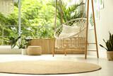 Comfortable hammock chair in stylish room. Home interior