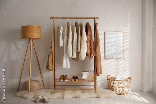 Modern dressing room interior with rack of stylish shoes and women's clothes - fototapety na wymiar
