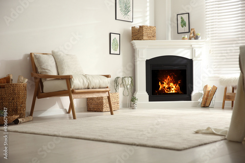 Fotografija Bright living room interior with fireplace and armchair