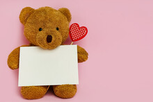Cute Teddy Bear With Red Heart And Blank Card On Pink Background, Space For Text. Valentine's Day Celebration