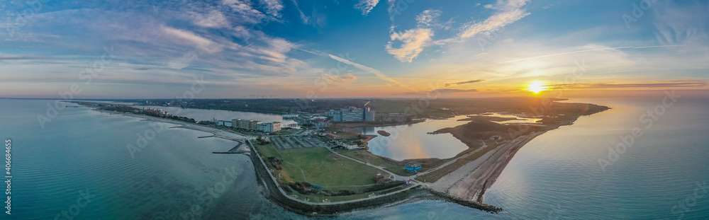 Fototapeta Beautiful aerial view of coastal landscape at the Baltic Sea by Heiligenhafen, Schleswig-Holstein, Germany. StunnStunning view from Baltic Sea coastline with Heiligenhafen holiday park on inland lake.